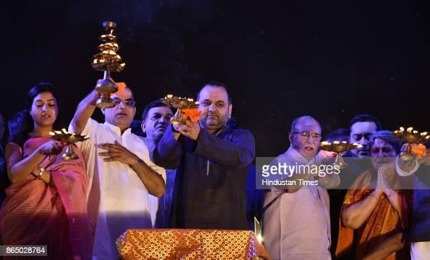 Delhi Lt Governor Delhi LG Anil Baijal and BJP leader Mahesh Giri AAP leader Alka Lamba seen during the Yamuna Aarti at Kudsia Ghat on October 21...