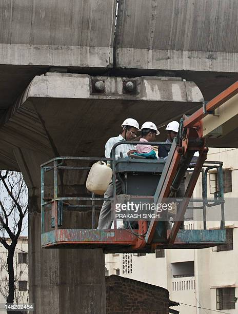 Delhi Metro Rail Corporation and Reliance Infrastructure engineers and workers check for faulty pillar and joints along the Delhi Metro Airport...