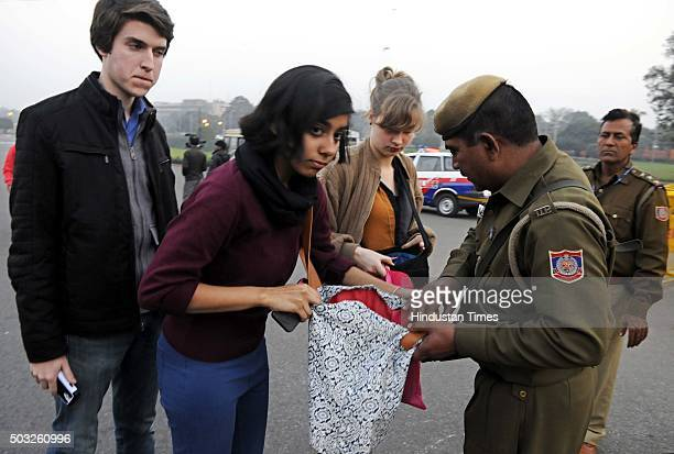 Delhi Police and CRPF security personnel checks the foreigners' bags at Raisina Hill after authorities received a bomb threat after the fresh firing...