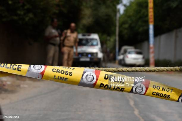 Delhi Police barricading at the site of an encounter between the Special Cell and a gang of criminals in the Fatehpur Beris Chanan Hola village near...