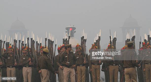Delhi Police battalion rehearses for Republic Day Parade during a cold and foggy day on the first day of New Year 2014 at Vijay Chowk on January 1...
