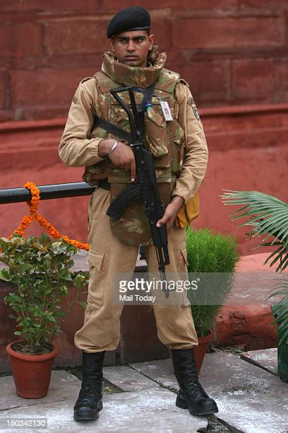 Delhi police commando guard stand during 66th Independence Day function at Red Fort in New Delhi on Wednesday