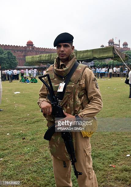 A Delhi police commando stands guard during the full dress rehearshal for the 67th Independence Day celebrations at the Red Fort in New Delhi on...