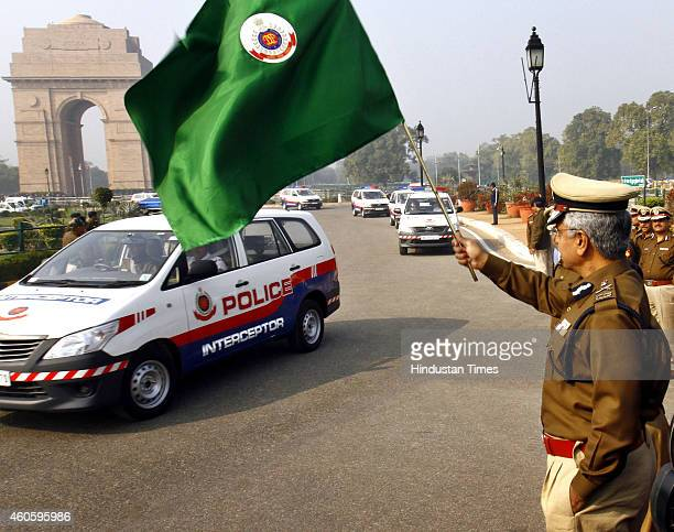Delhi Police commissioner BS Bassi flagging off the new interceptor vehicles at India Gate on December 17, 2014 in New Delhi, India. To rein in the...