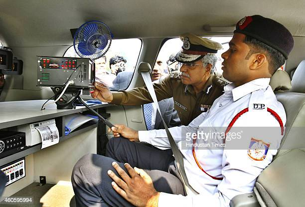 Delhi Police commissioner BS Bassi inspecting the new interceptor vehicle after their flag off at India Gate on December 17, 2014 in New Delhi,...