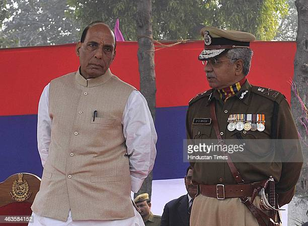 Delhi Police Commissioner BS Bassi with Union Home Minister Rajnath Singh as the Chief Guest during the Raising Day Parade organized by Delhi Police...