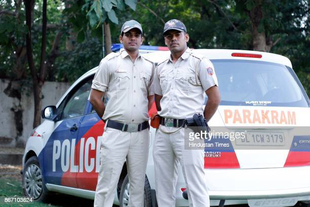 Delhi Police Constables Munesh Kumar and Parveen Kumar drivers of Parakram Vans at Police Control room Model Town on October 24 in New Delhi India...