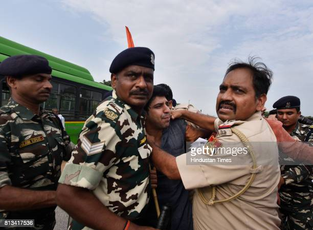 Delhi Police detain protesters during the protest at Vijay Chowk against the killing of seven Hindu pilgrims during the Amarnath Yatra in Kashmir on...