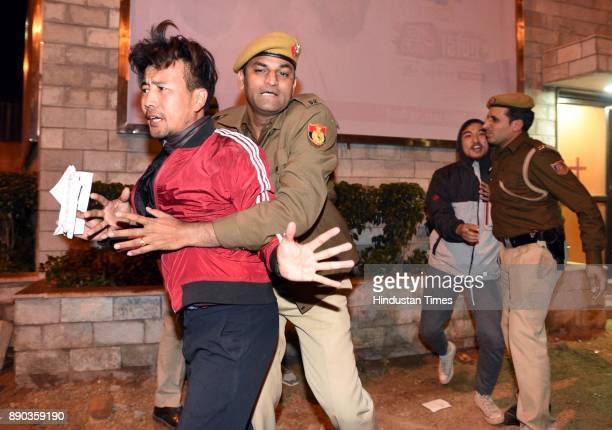 Delhi police detains an exile Tibetan protesting against China's occupation in Tibet outside the hotel at Janpath Road where Chinese Foreign Minister...