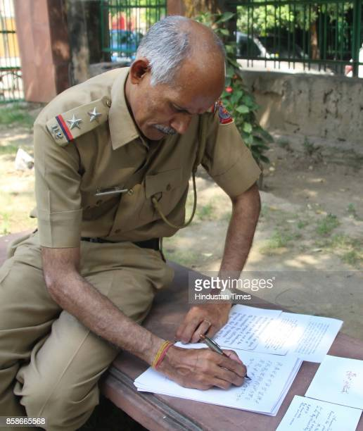Delhi Police Head Constable PP Shyamalan also known for his calligraphic handwriting 'Constable Calligrapher' poses during an exclusive interview...