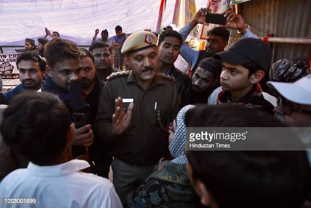 Delhi Police officials speak to protesters at Shaheen Bagh on February 24, 2020 in New Delhi, India. Newly appointed Deputy Commissioner of Police...