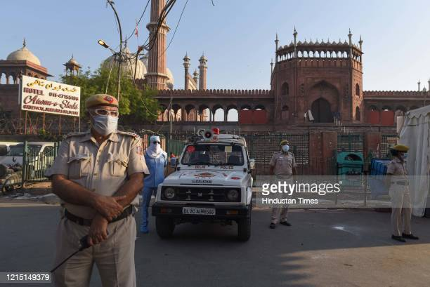 Delhi Police personnel on guard at Jama Masjid with people advised to offer prayers at home on Eid-ul-Fitr during lockdown against coronavirus on May...