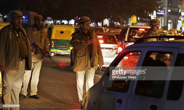 Delhi Police Personnel vigil at Connaught Place after high alert was declared following a bomb blast at Bengaluru on December 29 2014 in New Delhi...