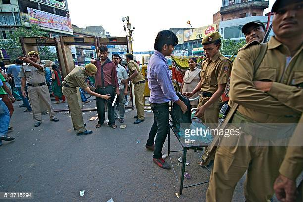 Delhi Police security officials on high alerts in all areas of market due to heavy crowd on the occasion of Dhanteras on October 30 2013 in New Delhi...