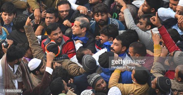 Delhi Police seen trying to detain Bhim Army chief Chandrashekhar Azad during a protest against a new citizenship law after Friday prayers at Jama...