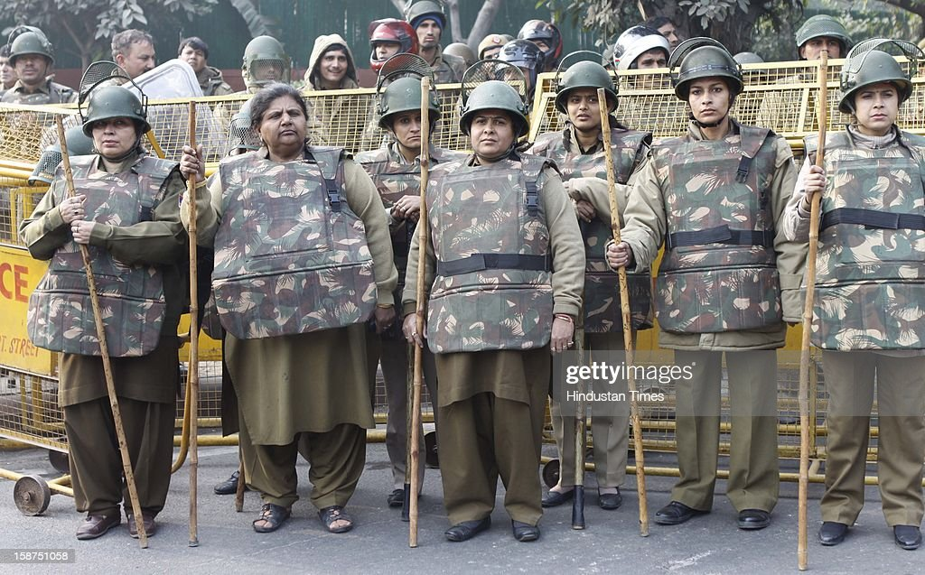 Delhi police stand guard in front of a barricade to stop from approaching a barricade on their way to India Gate while protesting against a recent gang-rape on December 27, 2012 in New Delhi, India. Indian Prime Minister Manmohan Singh pledged Thursday to take action to protect the nation's women while the young rape victim was flown to Singapore for treatment of severe internal injuries.