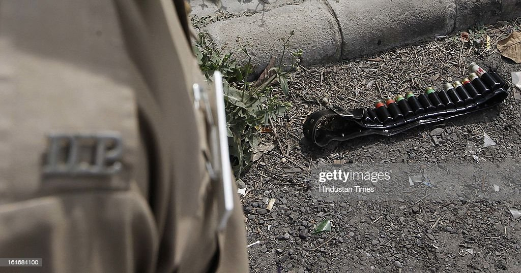 Delhi police team on the spot and carrying out preliminary investigations after a man opened fire at 28 year old Nidhi and her father Bhishan singh(58) outside the karkardooma Metro station, on March 26, 2013 in New Delhi, India.Nidhi died on spot.