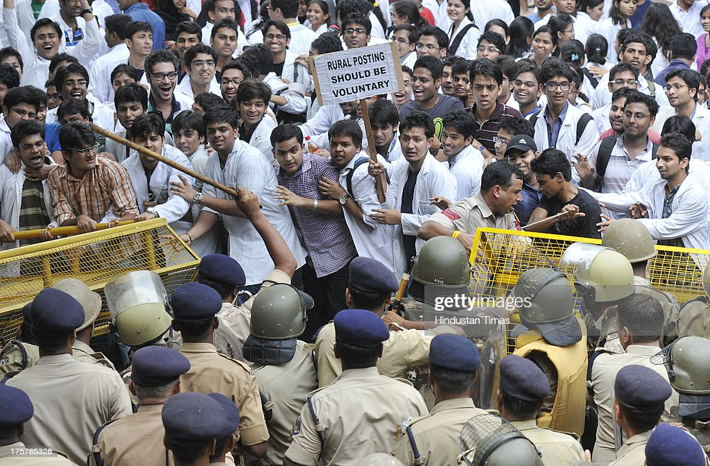 Delhi Police trying to stop medical students and doctors demonstrating during Save the Doctor campaign under the aegis of the Indian Medical Association and the Association of Healthcare Providers India at Jantar Mantar on August 8, 2013 in New Delhi, India. The doctors are protesting against the government's decision to make one year rural posting compulsory for medicos applying for post-graduation entrance exams.