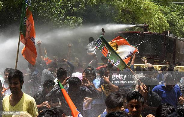 Delhi Police use water cannons to disperse Delhi BJP workers during a protest outside the residence of Delhi Chief Minister Arvind Kejriwal demanding...