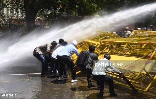 Delhi Police using water cannon to stop the members of Samta Sainik Dal and Bhim Army during a protest against the UP government over the arrest of...
