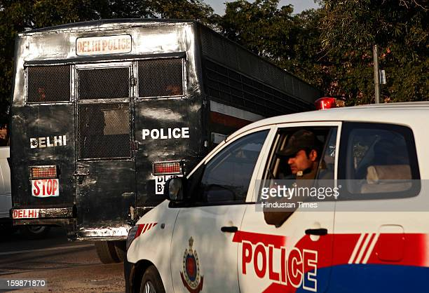 Delhi police van believed to be carrying five men accused over the brutal gang rape and murder of a young woman enters a district court for their...