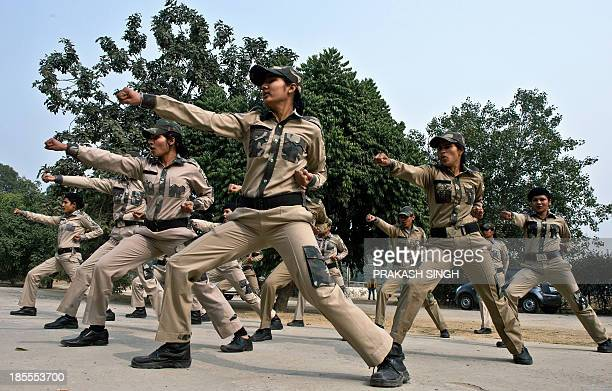 Delhi Police women commandos do warm up excercises in New Delhi on January 16 2013 A government plan to improve policing following criticism after...