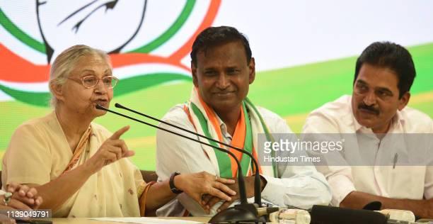 Delhi Pradesh Congress Committee President Sheila Dikshit addresses the audience as former Bharatiya Janata Party leader and MP Udit Raj joins...