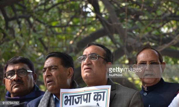 Delhi Pradesh Congress Committee President Shri Ajay Maken stands as he leads a demonstration demanding the resignation of ruling Aam Aadmi Party's...