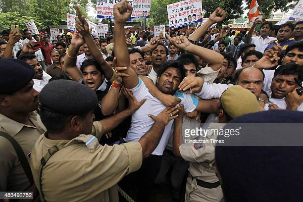 Delhi Pradesh Congress Committee workers protest against the Aam Aadmi Party government over the issue of disability pension and senior citizen...