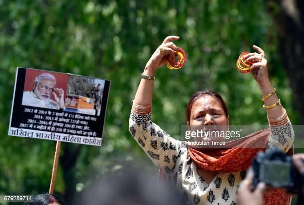Delhi Pradesh Mahila Congress protests at BJP headquarters against the Modi government's failure to control cross border terrorism and recent naxal...