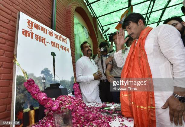Delhi Pradesh President Manoj Tiwari paying homage to CRPF martyrs who died in Sukma after MCD results at party office on April 26 2017 in New Delhi...