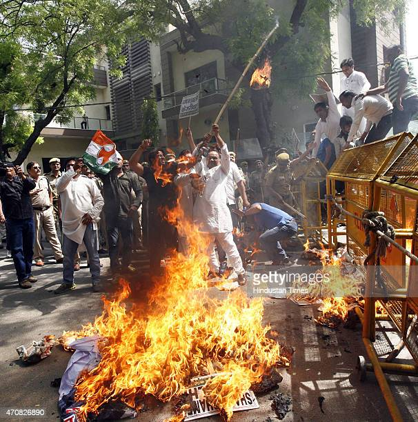 Delhi Pradesh Youth Congress burning effigy of Delhi Chief Minister Arvind Kejriwal during protest outside his house during a protest against the...