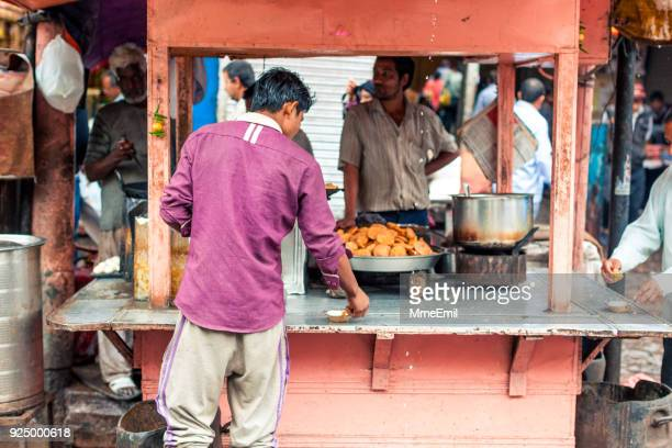 delhi street life - samosa stock photos and pictures