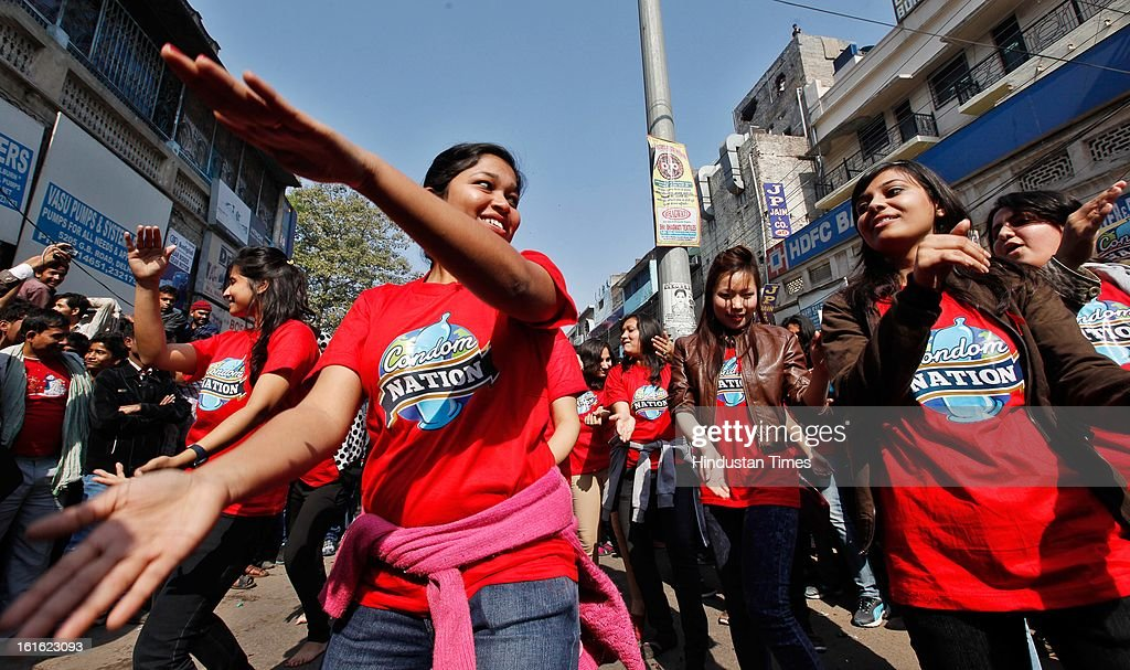 Delhi students take part in a flash mob to spread safe sex awareness on the occasion of International Condom Day on February 13, 2013 in New Delhi, India. AIDS Healthcare Foundation (AHF) organised a 'Safe Sex Awareness' event in the Indian capital to promote the use of condom to prevent spread of HIV infections and sexually transmitted diseases.