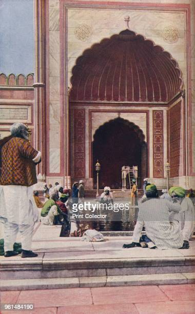 Delhi. Through the Jama Masjid gates the pilgrim enters a fine courtyard, 325 feet square, with a marble basin in its midst', circa 1930s. From...