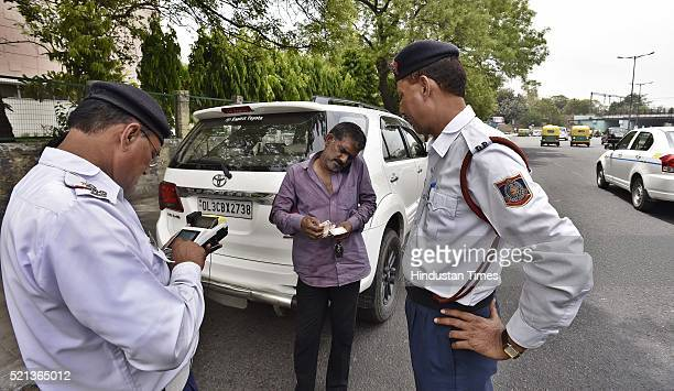 Delhi Traffic policemen issue a challan to a commuter for driving an evennumber vehicle during the 1st day of the second phase of the oddeven scheme...