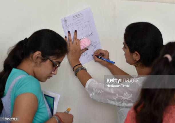 Parents wait as students fill their admission forms for the new academic session 201819 at Daulat Ram College on June 20 2018 in New Delhi India