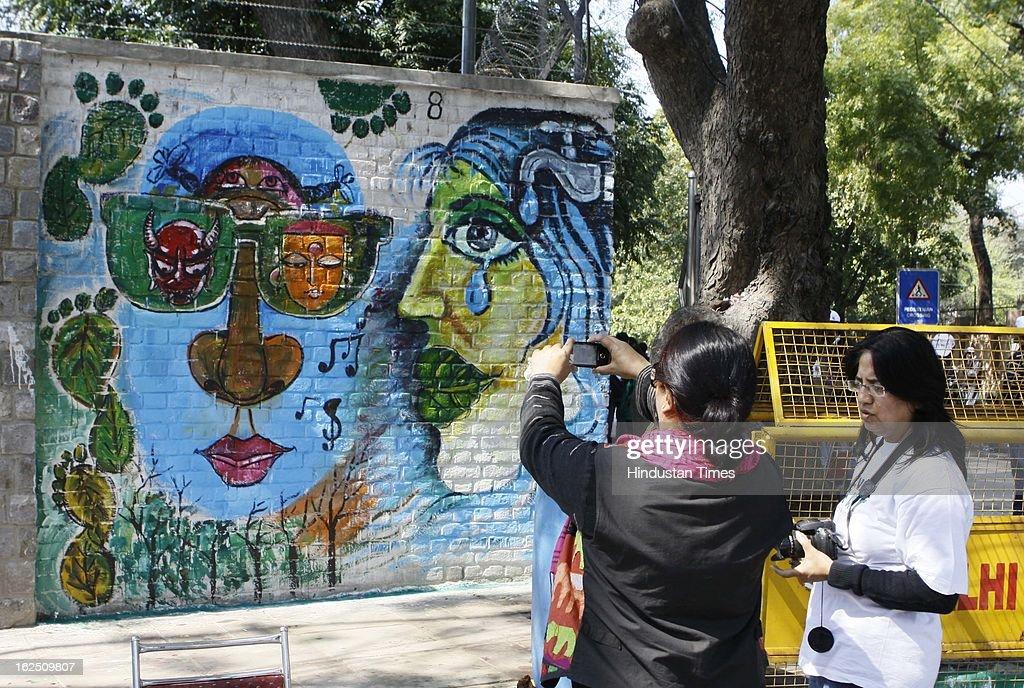 Delhi University students and NGO volunteers painting on the walls make 'Graffiti' at North Campus Delhi University on February 24, 2012 in New Delhi, India.