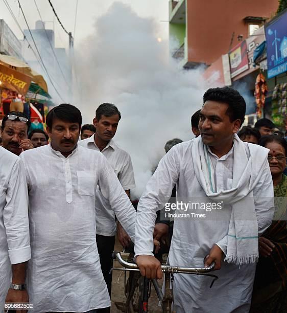 Delhi Water Minister Kapil Mishra and BJP MP Manoj Tiwari during a fumigation drive at Sonia Vihar to protect residents from Dengue and Chikungunya...