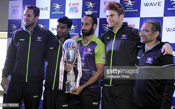 Delhi Waveriders captain Sardar Singh chief coach Cedric D Souza and team players Ram Diwakar Hayward Andrew and Pieterse Erasmus hold Hockey India...