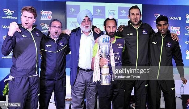 Delhi Waveriders captain Sardar Singh, veteran Indian hockey player Ajit Pal Singh, Chief Teams Coach Cedric D Souza and other team members hold...