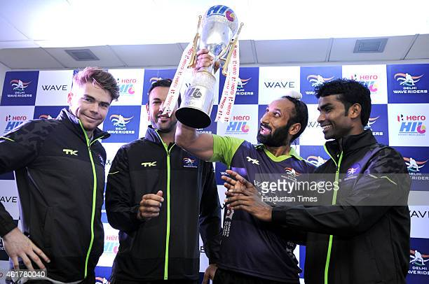 Delhi Waveriders captain Sardar Singh with teammates Andrew Hayward Pieterse Erasmus and Ram Diwakar hold Hockey India league 2015 Trophy during a...