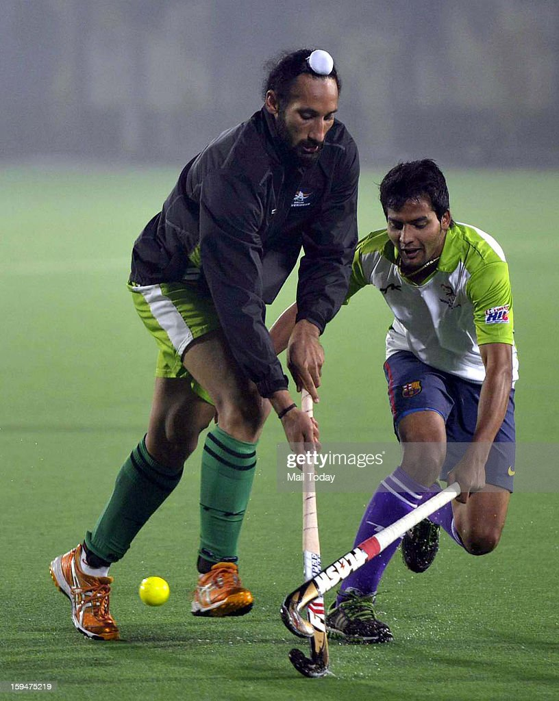 Delhi Waverriders captain Sardar Singh (L) and Yuvraj Walmiki during a practice session ahead of Hockey India League at National Stadium in New Delhi on Sunday.
