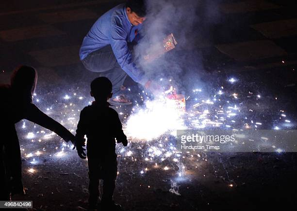 Delhiites burst crackers as they celebrate Diwali the festival of Lights on November 11 2015 in New Delhi India Diwali is an ancient Hindu festival...