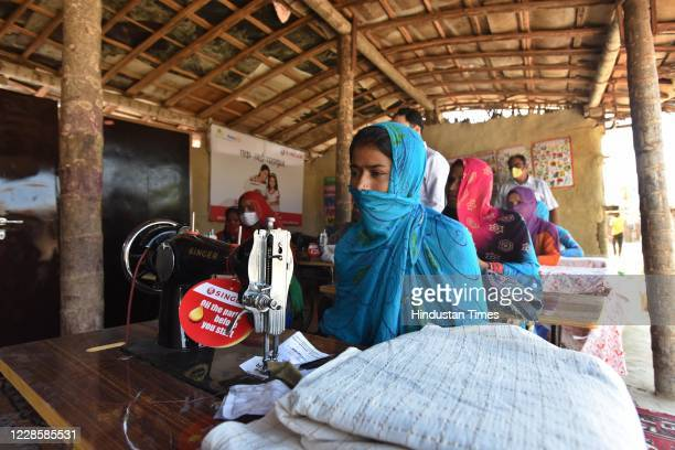 Delhi's Pakistani Hindu refugees seen with sewing machines donated by the rotary club of Delhi on the occasion of Prime Minister Narendra Modis 70th...