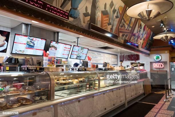 Deli counter with extensive signage at Ben's Kosher deli a classic Jewish deli in Westbury New York March 19 2018