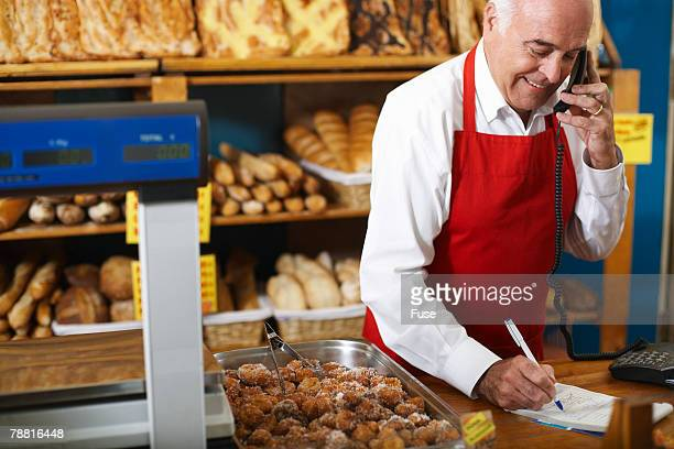 Deli Owner Taking Order By Telephone