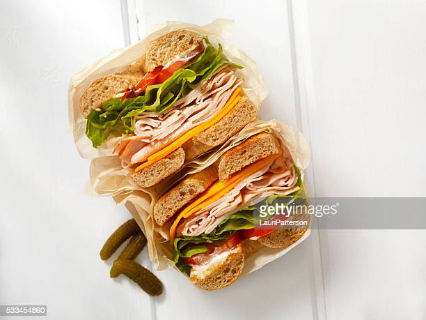 deli style turkey bagel sandwich - delicatessen stock pictures, royalty-free photos & images