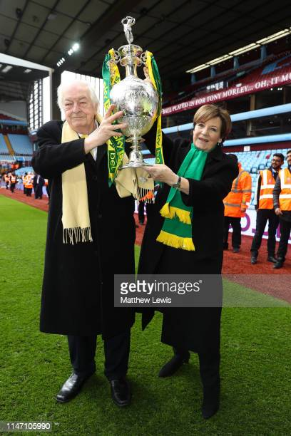 Delia Smith and husband Michael WynnJones lift the championship trophy in celebration after the Sky Bet Championship match between Aston Villa and...