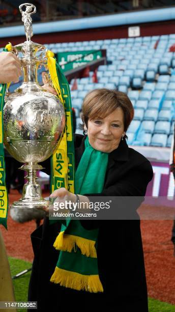 Delia Smith of Norwich City lifts the Championship trophy following the Sky Bet Championship game between Aston Villa and Norwich City at Villa Park...